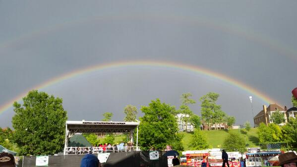 A double rainbow over the #WCBCC14 .    Rain can't dampen everyone's spirit. http://t.co/sWGE7KQ7hm