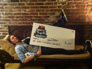 DJ GLOtron maxing and relaxing with his prize check from Red Bull after the Thre3Style contest.