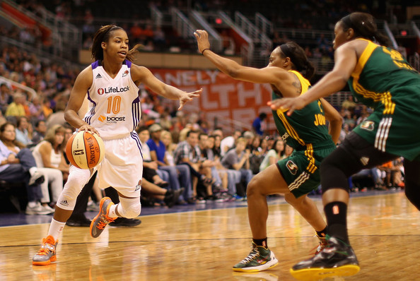 Phoenix Mercury point guard Jasmine James (left) was among the WNBA players who were shocked after learning the Los Angeles Sparks' ownership had ceased operations Thursday and laid off its entire front office. Still, the former Bartlett High and Georgia star believes the Sparks will play an 18th WNBA season this year. (Photo by Christian Petersen/Getty Images)
