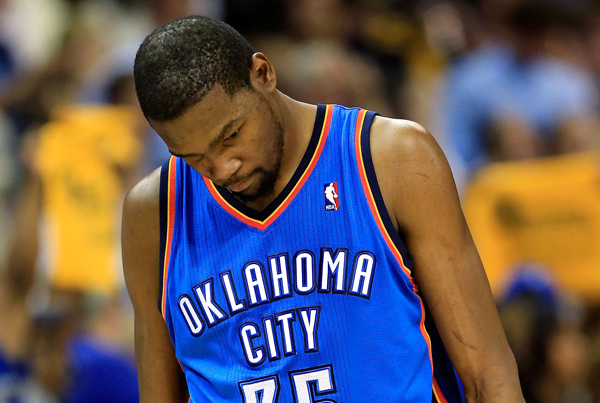 THUNDER STORM --- Despite averaging 28.8 points during last year's playoff series against Memphis, Durant and Co. were eliminated in five games. (Photo by Joe Murphy/Getty Images)