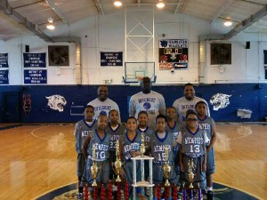 WILDCAT FORMATION --- Former Memphis State basketball standout Ernest Smith (center back row) is starting to become a fixture on the local AAU coaching circuit. Smith's Memphis Wildcats 9-and-under team has enjoyed much success as one of the area's youngest units. (Photos submitted by Ernest Smith)