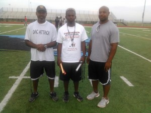 PROVEN LEADERS --- Among the reasons Texas SWAG Track And Field has been a success is because its coaches boast a wealth of experiences. (From left to right): Ricky Madison, Texas SWAG founder William Henderson, and Isaac Bell.  (Not pictured): Trey Bates, Bob Bell, Tommy Cauley, Tommy Hamilton, Renwick Ridgeway, John Stewart
