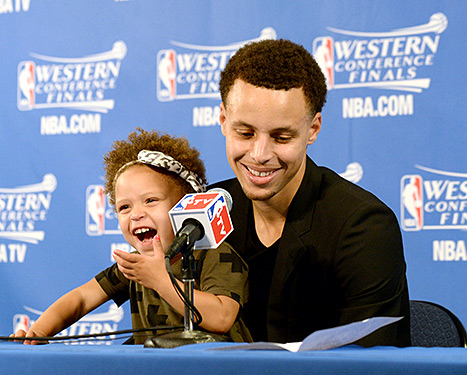 THE REAL MVP --- Although Golden State Warriors star point guard Stephen Curry was named league MVP recently, his two-year-old daughter Riley essentially stole the show during Tuesday night's postgame news conference after the Warriors' 110-106 come-from-behind win against the Houston Rockets in Game 1 of their Western Conference Finals best-of-7 series. (Photos by Noah Graham/NBAE via Getty Images)
