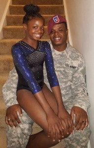 """DADDY'S GIRL --- Among the reasons is that Leeiah Davis, a Winter Haven, Florida native whose family currents resides in Fort Meade, Maryland, made her competitive gymnastics debut in Europe --- Vicenza, Italy to be exact.  That's because Leeiah was --- and still is --- a military child, considering her father, Demetrius Davis, is a longtime soldier in the United States Army.  In fact, as Leeiah --- who's also competed briefly while living in Killeen, Texas --- tells it, her continuous rise as a young gymnast would not have come full circle if not for the viable presence of her father who, according to her mother, endures what she describes as """"separation anxiety,"""" particularly when her father is on assignment for the country."""