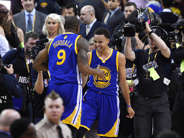 MISSION ACCOMPLISHED --- Golden State Warriors Stephen Curry and MVP Andre Iguodala celebrate after their team defeated the Cleveland Cavaliers in Game 6 to win the 2015 NBA Finals on June 16, 2015 at the Quicken Loans Arena in Cleveland, Ohio. The Warriors took the best-of-seven series four games to two over the Cavaliers to claim their first title since 1975. (Photo by Timothy Clary/Getty Images)