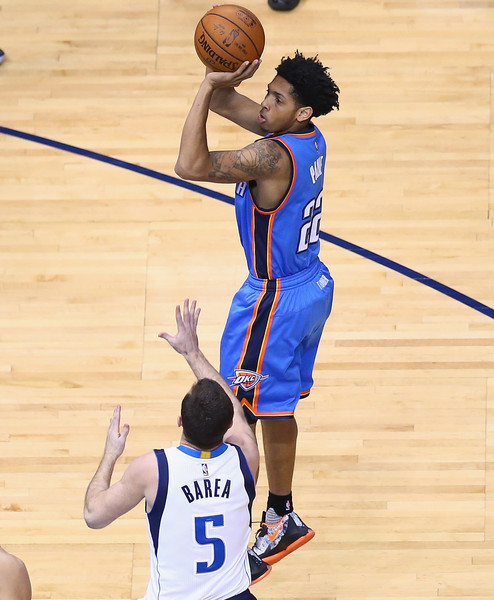 INVOKING PAYNE --- Oklahoma City Thunder reserve rookie point guard Cameron Payne has played a key role in team's season-best seven-game winning streak. His eight points on 4 of 10 shooting helped propel the Thunder to a 109-106 come-from-behind win Friday night Dallas. (Photo by Ronald Martinez/Getty Images)