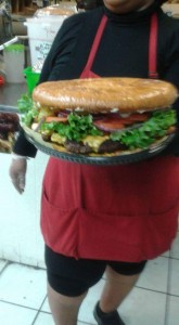 """OH WOW!!!!! Dallas' Trucker's Café has emerged as a fixture, in large part because of its featured menu item, the famous """"Mothertrucking"""" Burger, a massive, bicycle-tire-size cheeseburger that will make a customary size burger seem like those sold at the White Castle franchises."""
