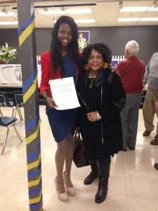 TRUE GENIUS --- Johnson is an honor student who is well on her way to graduating in the top 10 percent of her graduating class in the spring.