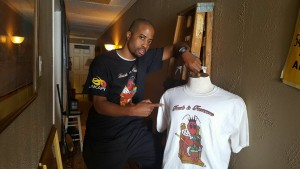 """A TRUE TALENT --- Just like possessing a job to drive trucks, he's making his presence felt in his latest ambition, a trend that appears to have drawn rave reviews from his grandest of supporters, far and near. Memphis-based business owner Nik Jackson is owner and chief executive officer of JBAKARI Clothing Company, a rising, trendy-savvy, stylish apparel establishment that, in Jackson's own word, was built """"on the word of God inspires you through cotton."""""""